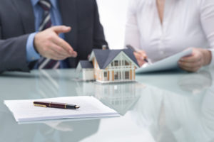 realtor explaining contracts when building a custom home