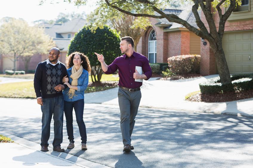 realtor showing neighborhood good for building a custom home